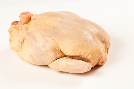 Fresh uncooked chicken. Isolated studio shot over white board photo