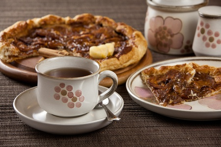 cup of tea or coffee and a lovely heart shaped and sliced apple tart photo