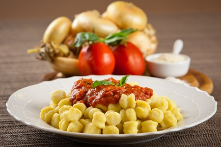 Cooked plate of homemade pasta with ingredients. Tomato, onion, flour, parmesan cheese