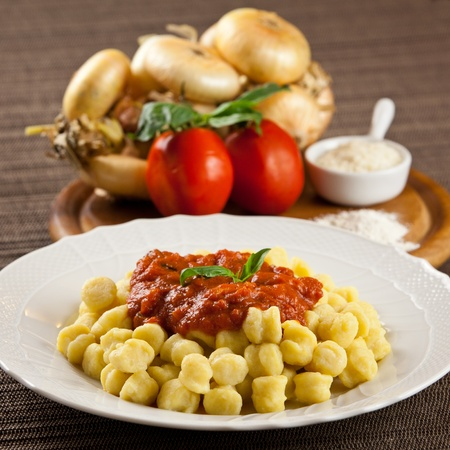 Hot cooked plate of freshly made pasta with ingredients. Tomatoes, onions, flour, parmesan cheese Archivio Fotografico