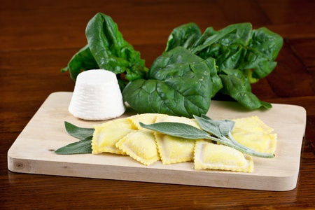 Homemade ravioli filled with ricotta cottage cheese and spinach topped with fresh sage