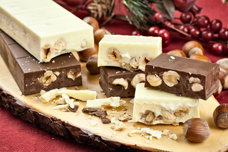 White and dark chocolate nougat over a wood board with christmas decorations