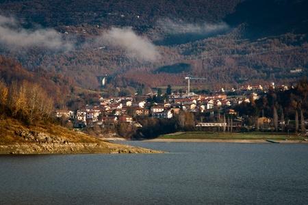 View of Borgo San Pietro from Lago del Salto in a misty morning photo
