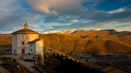 Scenery view of ancient church of Santa Maria della Pietà in Italy and Appennini mountain in background photo