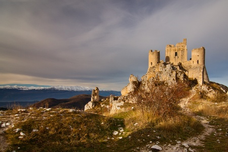Castle of Calascio ruins at sunrise from the arriving path Stock Photo