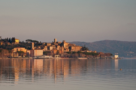 umbria: View of small village of Passignano sul Trasimeno in Italy at sunset