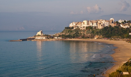 outpost: Panoramic aerial view of Sperlonga and Torre Truglia wit mount Circeo in background and beautiful sandy beach in foreground Stock Photo