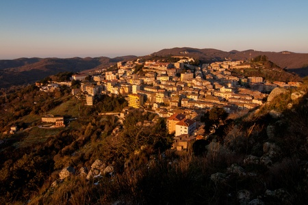 View of rural village of Tolfa in central Italy lighted with golden morning sun Stock Photo