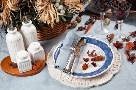Red white and blue elegant dinnerware for holidays and celebrations table and place setting photo