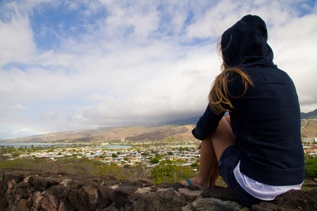 Blond girl staring at Diamond Head view wearing an hoodie