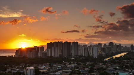 View of Honolulu city at sunset with beautiful sky and clouds photo