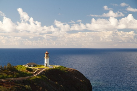 Kilauea lighthouse northern guide in Kauai island with calm ocean in background