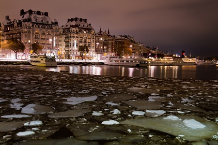 View of old builbings in Stockholm form the harbour with iced sea