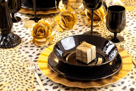 #11988577 - Golden gift box in a black and gold table setting with gold roses over a leopard tablecloth & Golden Gift Box In A Black And Gold Table Setting With Gold Roses ...
