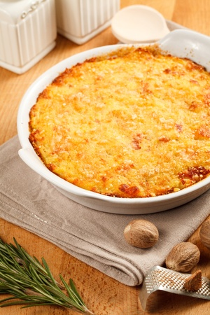 Traditional gateau potatoes pie with cheese and nutmeg. Served in a terrine over a wooden board Stock Photo - 12133346