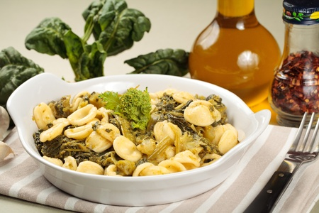 Traditional orecchiette pasta with turnip tops. Spicy recipe from Apulia, in southern Italy Stock Photo