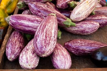 Box of fresh eggplants at market booth Stock Photo - 12551780