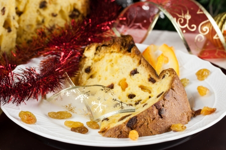 Typical Italian Christmas Pudding with raisins and candies  Christmas tree and decorations in background Stock Photo
