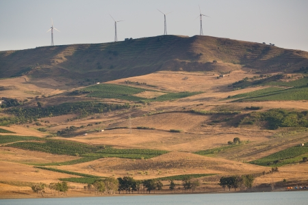 View of cultivated hills and electricity wind mills on Jato Partinico lake in Sicily - Italy Stock Photo