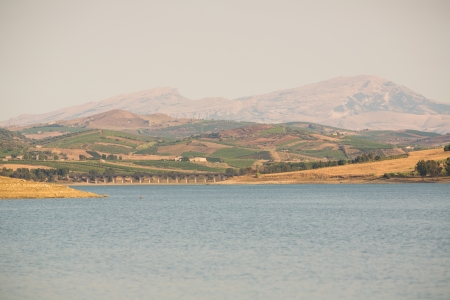 View of Jato Partinico lake in Sicily - Italy  Man made lake with dame in summer time
