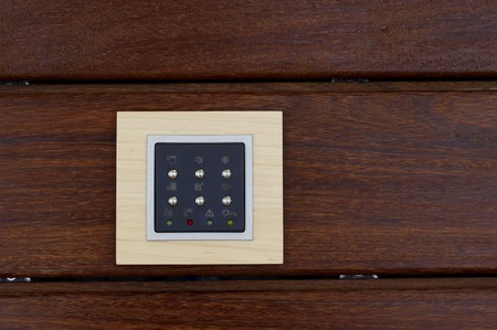 wood panelled: Switch board on wooden plank