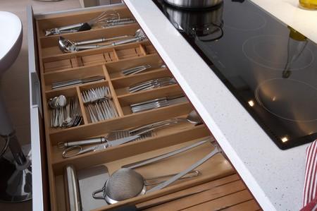 countertop: Cutlery kept in open drawer Stock Photo