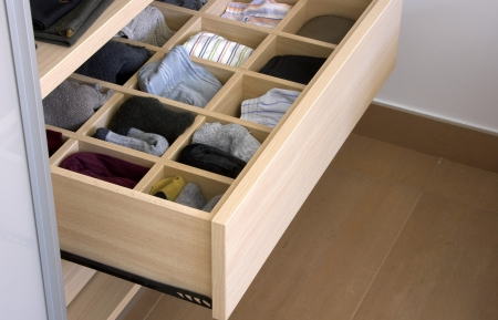 without clothes: Open wooden drawer in cupboard
