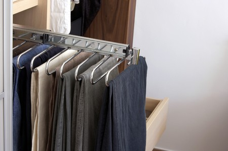 fitted unit: Pants on hanger in wardrobe