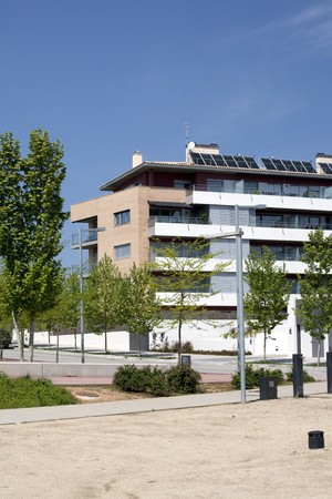 alternative living: Apartment building powered with solar energy