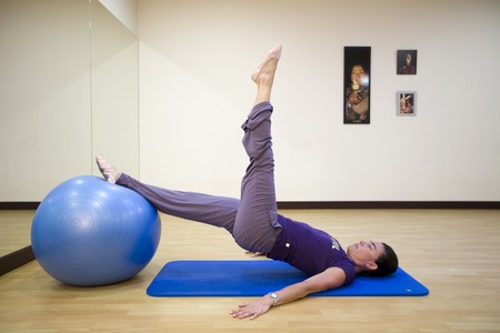 Woman exercising on a fitness ball photo