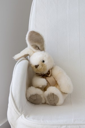 Close-up of a stuffed toy on a couch
