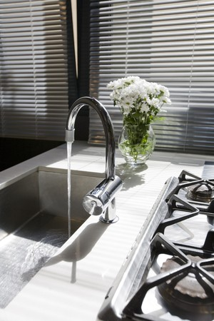 faucets: Interiors of a domestic kitchen
