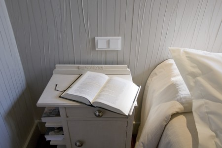 bedside: Book on a night table in a bedroom