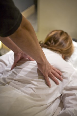 Close-up of a woman receiving a back massage photo