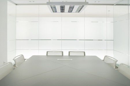 absent: Conference table and chairs in a board room Stock Photo