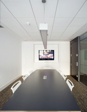 Conference table and chairs in a board room photo