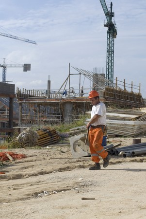 Worker working at a construction site Stock Photo