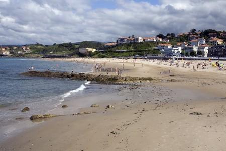 santander: Tourists on the beach, Comillas, Santander, Cantabria, Spain