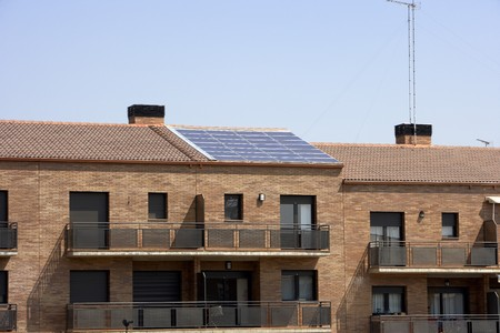 View of solar panel on a flats building roof LANG_EVOIMAGES