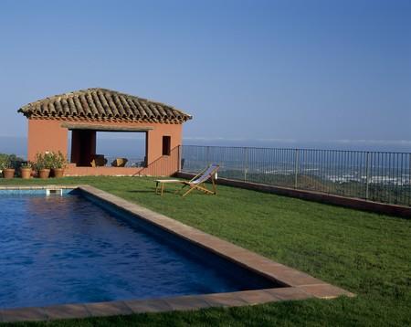 atop: A swimming pool atop a mountain