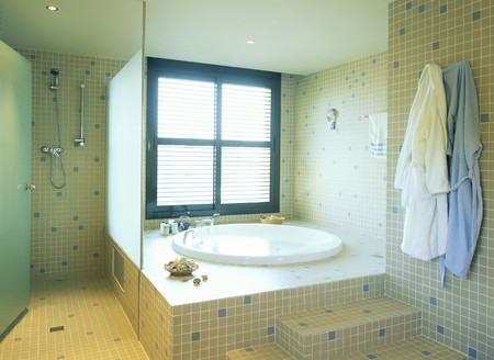 mediterranian style: View of a neat tiled bathroom