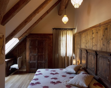 wooden beams: View of a lit bedroom