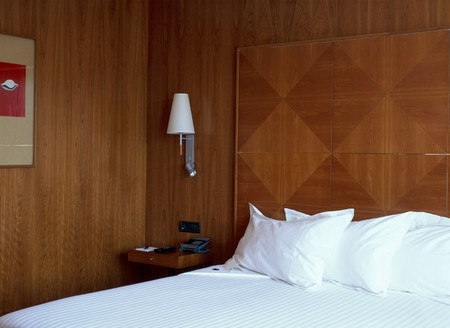 wood panelled: Partial view of a comfortable bed