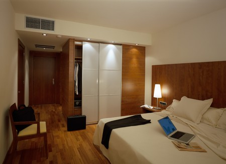 wood panelled: View of an illuminated bedroom