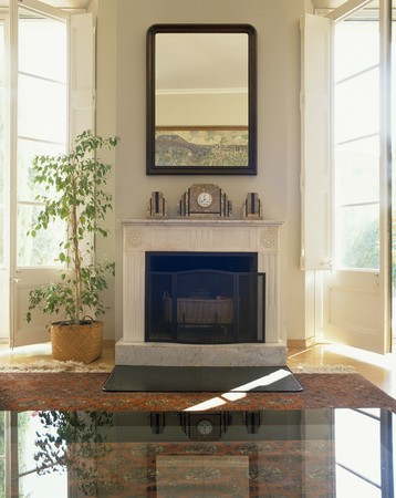 View of a mirror above a fireplace Stock Photo - 7215177