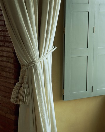 mediterranian homes: View of a curtain bound by a cord LANG_EVOIMAGES
