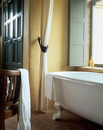 mediterranean home: View of a bathtub in a bathroom LANG_EVOIMAGES