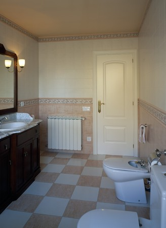 spanish tile: View of a lit bathroom