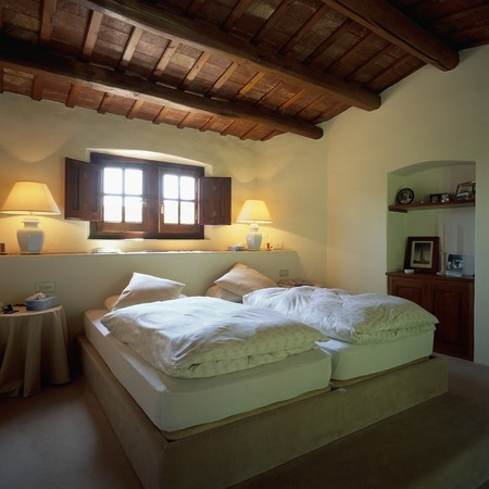 mediterranian homes: View of a cozy bedroom LANG_EVOIMAGES