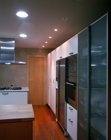 mediterranian style: View of a well equipped kitchen